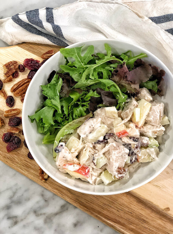 This chicken salad is sweet, savory, and crisp- all in one dish. Serve it on bread, on a wrap, or with crackers and fresh veggies for dipping. This week, I am serving mine over mixed greens with a raspberry vinaigrette from Bolthouse Farms.